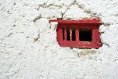 Old Red Window Frame On White Wall At Buddhist Monastery. India, Ladakh, Leh, Shey Monastery