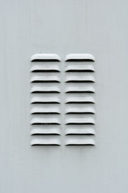 pic of louvers  - A gray metal ventilation louver with horizontal slots - JPG
