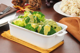 stock photo of crown green bowls  - Broccoli with cheese sauce and a bowl of tuna casserole - JPG