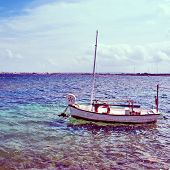 picture of a fishing boat in Estany des Peix lagoon, in Formentera, Balearic Islands, Spain, with a