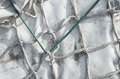 stock photo of tarp  - White Tarp Tied Up with Knotted Rope - JPG