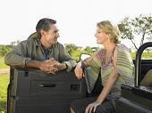 picture of  jeep  - Man and woman talking by the jeep against clear sky - JPG