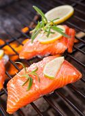 Grilled salmon steaks on fire