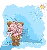 Little bear holding bunch of flowers