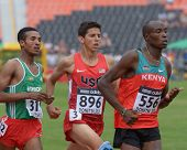DONETSK, UKRAINE - JULY 11: Amibelu, Ethiopia (left), Fisher, USA (center), and Kibiego, Kenya compete in heat on 1500 m during 8th IAAF World Youth Championships in Donetsk, Ukraine on July 11, 2013
