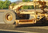 picture of land development  - Land Grader working the building pad of a new tennis court in Roseburg Oregon at Stewart Park - JPG