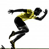 stock photo of sprinters  - one caucasian man young sprinter runner  in starting blocks  silhouette studio  on white background - JPG