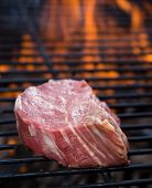 stock photo of braai  - closeup of steak on a grill - JPG
