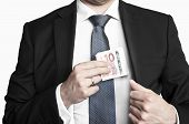 Businessman In Suit And Tie Hiding Money In His Pocket