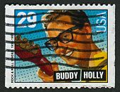 US - CIRCA 1993: A stamp printed in US shows image of the Charles Hardin Holley, known professionally as Buddy Holly, was an American singer-songwriter and a pioneer of rock and roll, circa 1993.