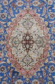 foto of tabriz  - fine detail of persian classic carpet background - JPG