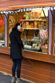 Brunette Woman Buying Candy At A Kiosk