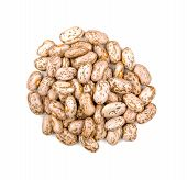 Heap of pinto beans on a white background