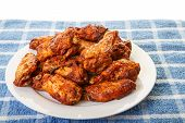 White Plate Of Chicken Wings On Blue Mat