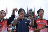 DONETSK, UKRAINE - JULY 14: Japanese fans make photos after the final round of medley relay during 8