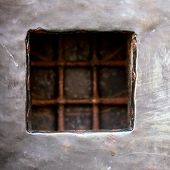 foto of stelles  - cell window with stell lattice in grey grunge metal pirson wall door as background - JPG