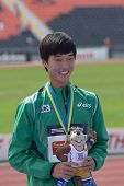 DONETSK, UKRAINE - JULY 14: Sanghyeok Woo of Korea with his gold medal in high jump during 8th IAAF