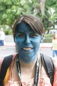 SAN DIEGO, CALIFORNIA - JULY 20: A woman with a green blue painted face attending the yearly Comic-Con convention on July 20, 2013 in San Diego, California.