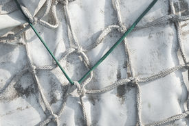 picture of tarp  - White Tarp Tied Up with Knotted Rope - JPG