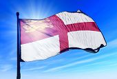 stock photo of sark  - Sark flag waving on the wind on the sky - JPG