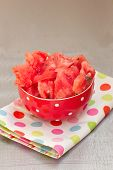 a watermelon chunks in  a white bowl