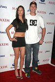 Travis Pastrana and guest at the MAXIM Magazine ICU Event. Area, Hollywood, CA. 08-02-07