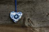 Blue Flowers Love Valentine's Heart Hanging On Wooden Texture Background