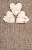 Burlap Background With Wooden Hearts