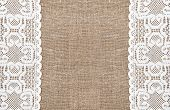 pic of rude  - Burlap rude background and white lacy cloth - JPG