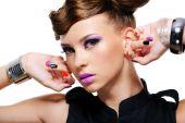 Portrait Of Beautiful Woman With Purple Make up