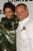 Wolfgang Puck and guest at the Chanel and P.S. Arts Party. Chanel Beverly Hills Boutique, Beverly Hills, CA. 09-20-07