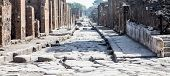 stock photo of cobblestone  - View down cobblestone street in ancient city of Pompeii - JPG