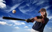 foto of softball  - portrait of baseball female batter hitting a flying ball - JPG