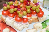 Canapes With Ham Tomato And Olive On A Toothpick