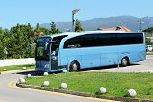Peloponnes, Greece - June 7: The Modern Bus For Tourists Transportation And Driver Are Near Hotel On