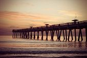 Jacksonville Beach Fishing Pier in early morning.
