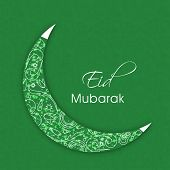Shiny green crescent moon on occasion of Muslim community festival Eid Mubarak celebrations.