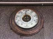 picture of barometer  - Russian vintage barometer on granite wall urban buildings - JPG