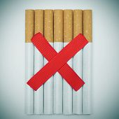 stock photo of slash  - a pile of cigarettes and two crossed red slashes - JPG