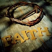 word faith and the Jesus Christ crown of thorns and a nail in the holy cross