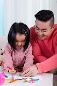 Asian Family Drawing Together