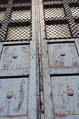 Old Door With Bars In The Sunlight