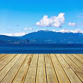 pic of lagos  - Beautiful view from wooden terrace to the Alps mountains at Lago Maggiore Italy - JPG