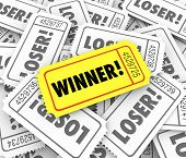 image of raffle prize  - Winner word on a golden or yellow ticket pile Loser tickets  lucky drawn winning entry  - JPG