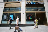 NEW YORK CITY - FRIDAY, JUNE 20, 2014:   Pedestrians walk past a FedEx Office store in New York City