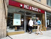NEW YORK CITY - FRIDAY, JUNE 20, 2014:   Pedestrians walk past a Pret A Manger coffee and sandwich store in New York City on Friday, June 20, 2014.