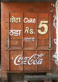 Boarded Up Little Shop With Coca-Cola Advertisement.