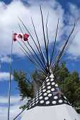 Canadian Flag Over Top Of Teepee.