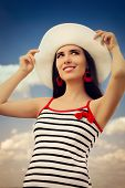 Beautiful Girl with Straw Hat on Blue Sky