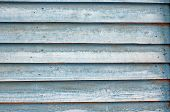 Texture Of Wall Of Blue Boards With Flaky Paint